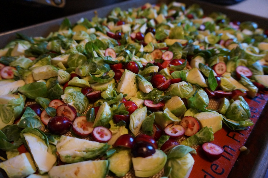 Toss the sprouts and sliced cranberries and drizzle with some EVOO!