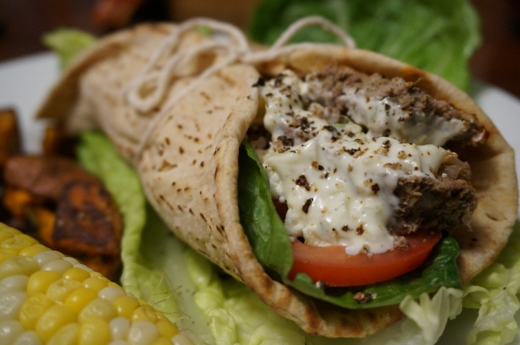 Top with desired toppings and tzatziki sauce, and wrap up in pita. Tie with a bow to keep it together!