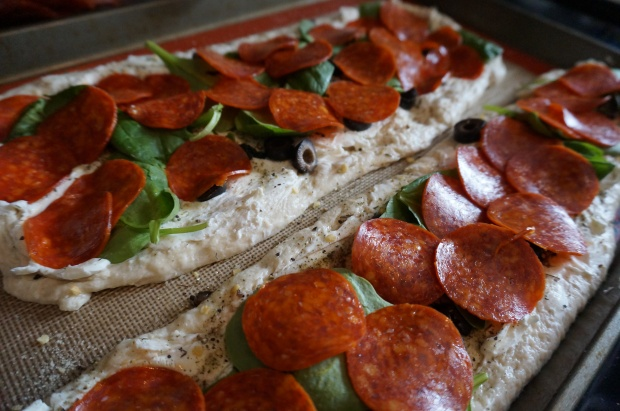 Add spinach and pepperoni on top.