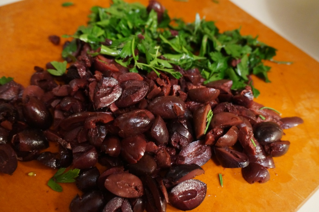 Top with kalamata olives, parsley and capers.