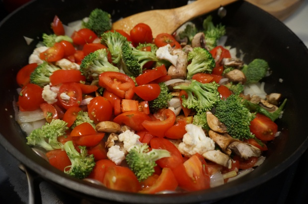 Add veggies to pan and cook, then simmer until squash is done.
