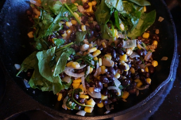 Cook onion with corn, beans, and cilantro.
