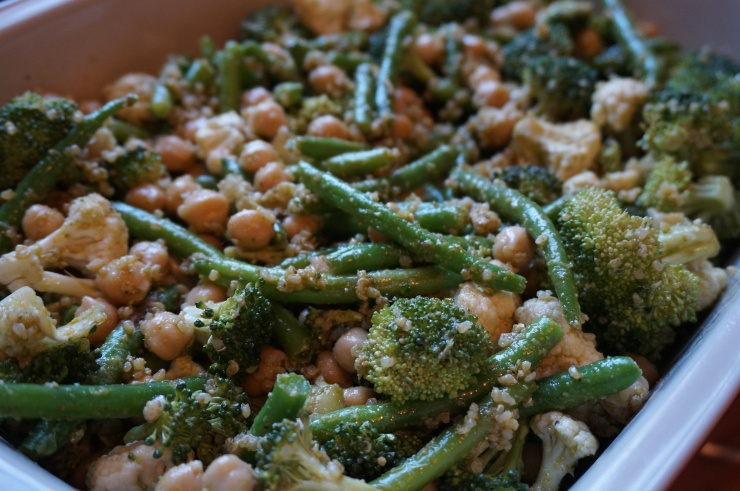 Prepare veggies in casserole dish with some of the pesto.
