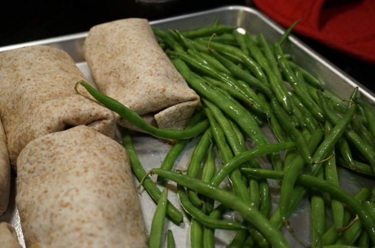 Place on hot baking sheet with green beans.